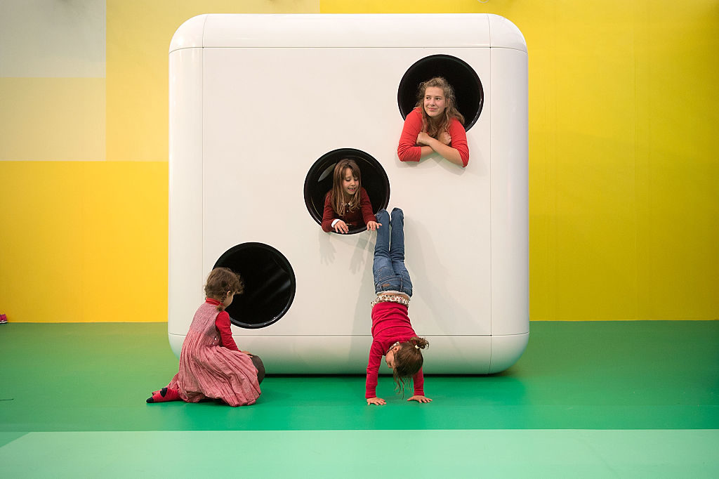 Children play at the opening of artist Carsten Holler's installation 'Gartenkinder.'