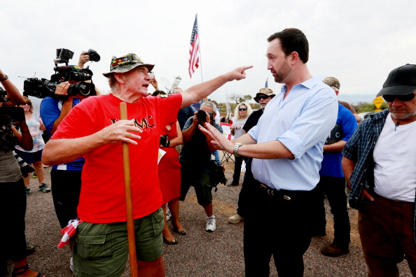 A Tea Party Patriot running for Congress  has a heated discussion with an anti-immigration activist during a protest in  Arizona.
