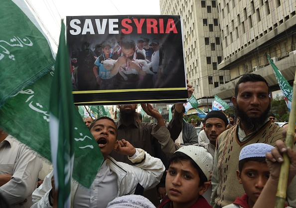 Pakistan demonstrators shout slogans during a rally on January 6, 2017, against the ongoing conflict in Syria. More than 310,000 people have been killed and millions forced to flee their homes since the conflict broke out in March 2011.
