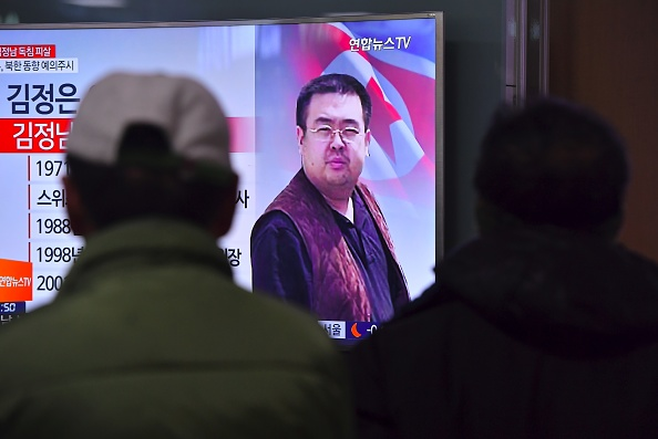 At a Seoul railway station, people watch news reports of the assassination in Malaysia of Kim Jong-Nam, the half-brother of North Korean leader Kim Jong-Un.