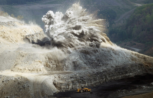 """An explosive is detonated at an A & G Coal Corp. surface mining operation in the Appalachian Mountains in 2012 in Wise County, Va. Critics refer to this type of mining as """"mountaintop removal,"""" which has destroyed 500 mountain peaks and at least 1,200 miles of streams while leading to increased flooding. The Appalachians are some of the oldest mountains on Earth."""