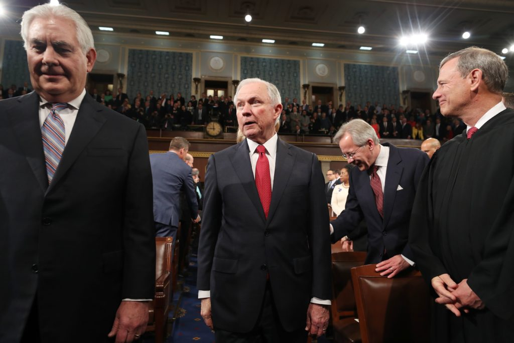 Secretary of State Rex Tillerson (L) and Attorney General Jeff Sessions (R) arrive for President Donald Trump's first address to a joint session of Congress.