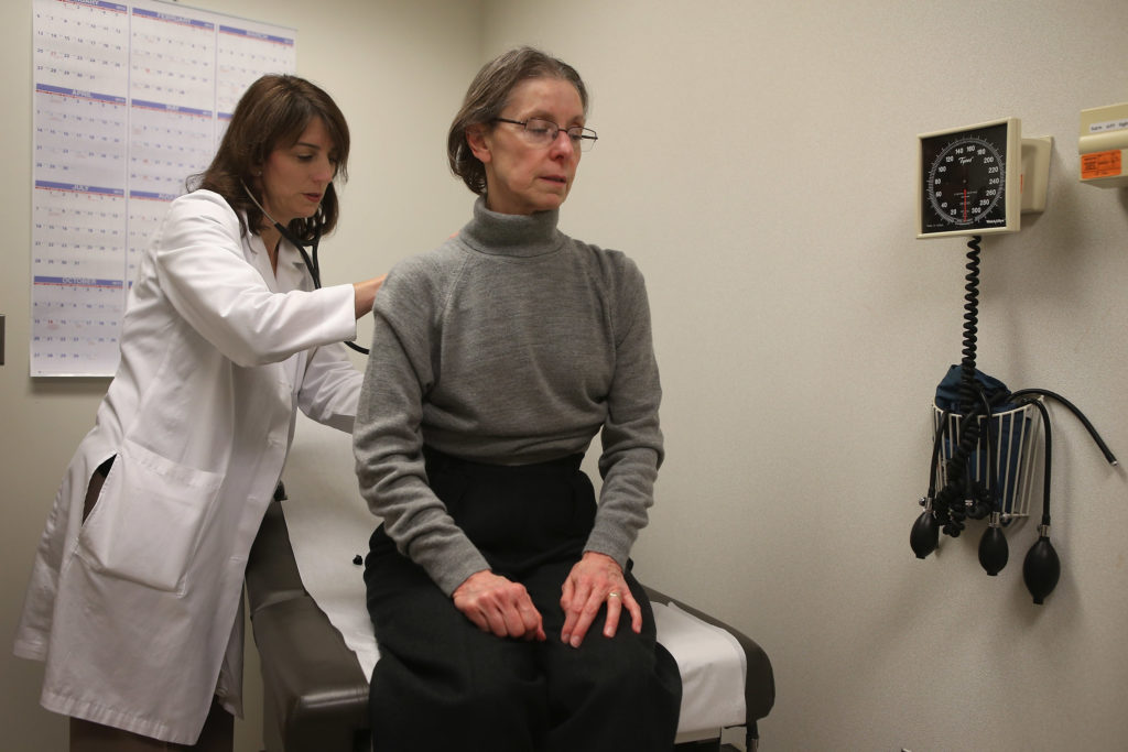 Dr. Anne Furey Schultz examines a patient complaining of flu-like symptoms at Northwestern Memorial Hospital in Chicago.