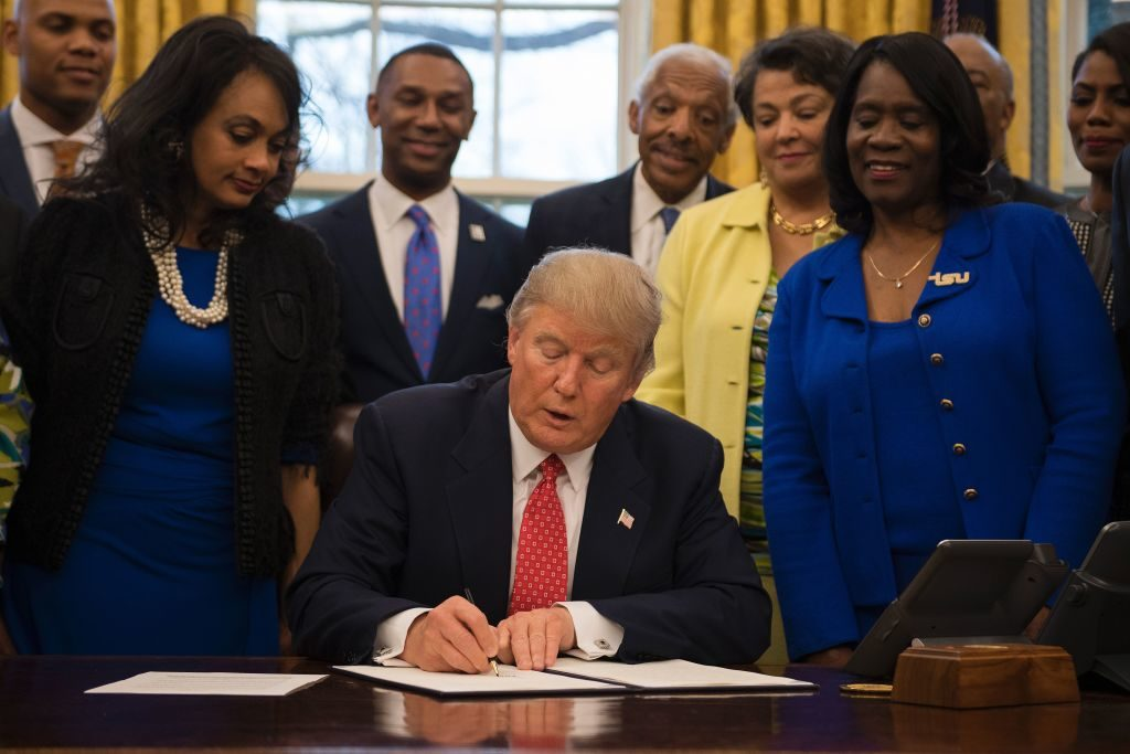 President Donald Trump signs an executive order to bolster historically black colleges and universities (HBCUs).