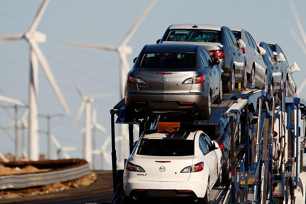 Diesel trucks and cars pass windmills near Banning, California.