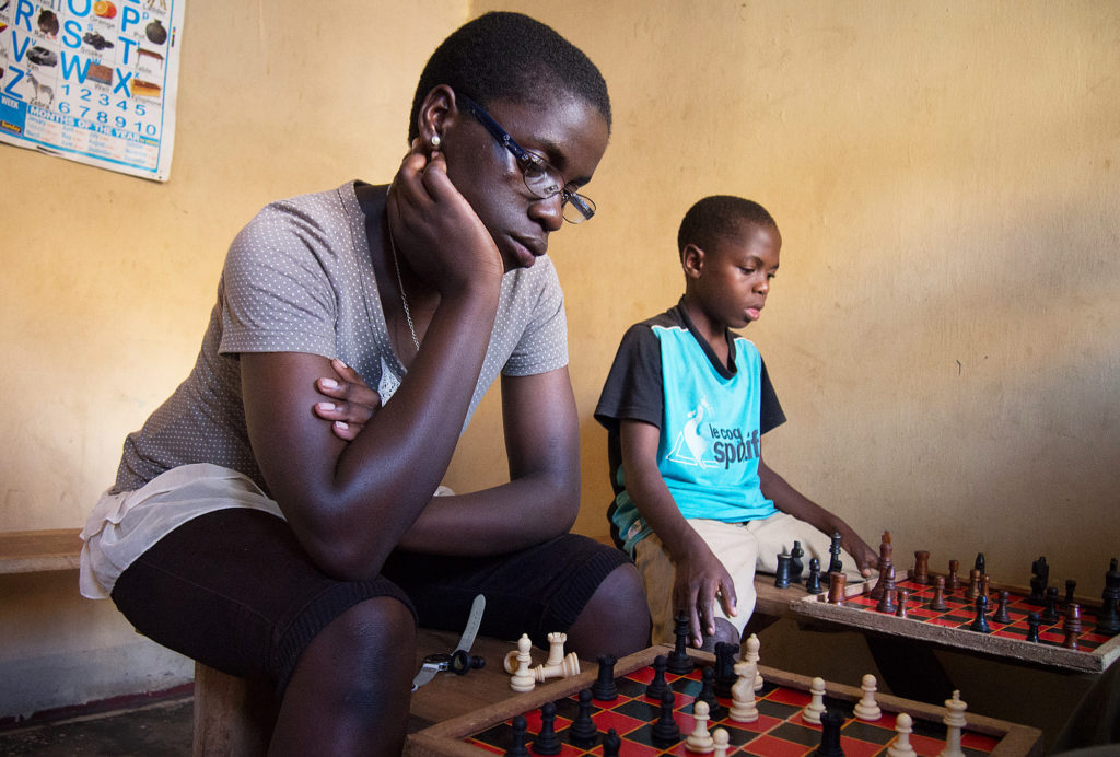 Phiona Mutesi (left) went from living rough on the streets of a Kampala slum to competing in chess' most prestigious international tournaments. Mutesi is the first female Ugandan to reach the level of candidate master.