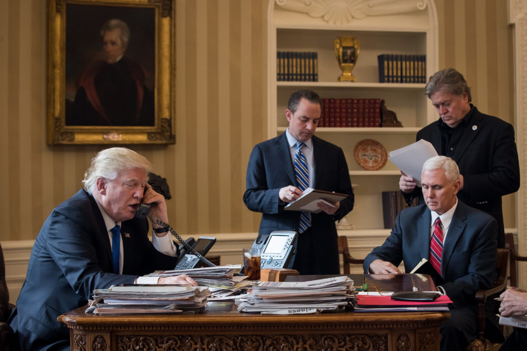 White House Chief of Staff Reince Priebus (center) in the Oval Office with President Donald Trump, Vice President Mike Pence, and White House Chief Strategist Steve Bannon.
