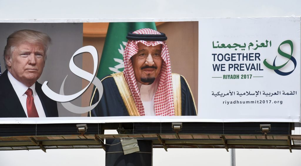 On a main road in Riyadh, a giant billboard bearing portraits of President Donald Trump and Saudi Arabia's King Salman will greet Trump on his first foreign trip since taking office.