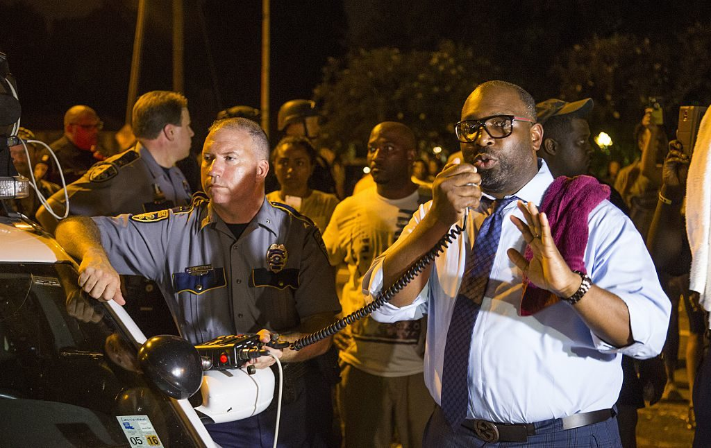 Baton Rouge councilman Lamon Cole, right, appeals to the protesters for calm July 8, 2016 in Baton Rouge, Louisiana.