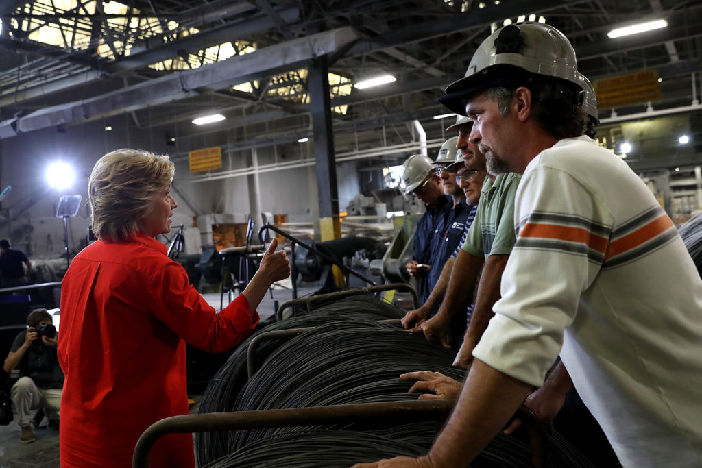 Democratic presidential nominee former Secretary of State Hillary Clinton greets steel workers in Johnstown, Pennsylvania during a campaign rally in July 2016.  Law professor Joan Williams argues that political elites and journalists remain clueless about white blue collar voters.