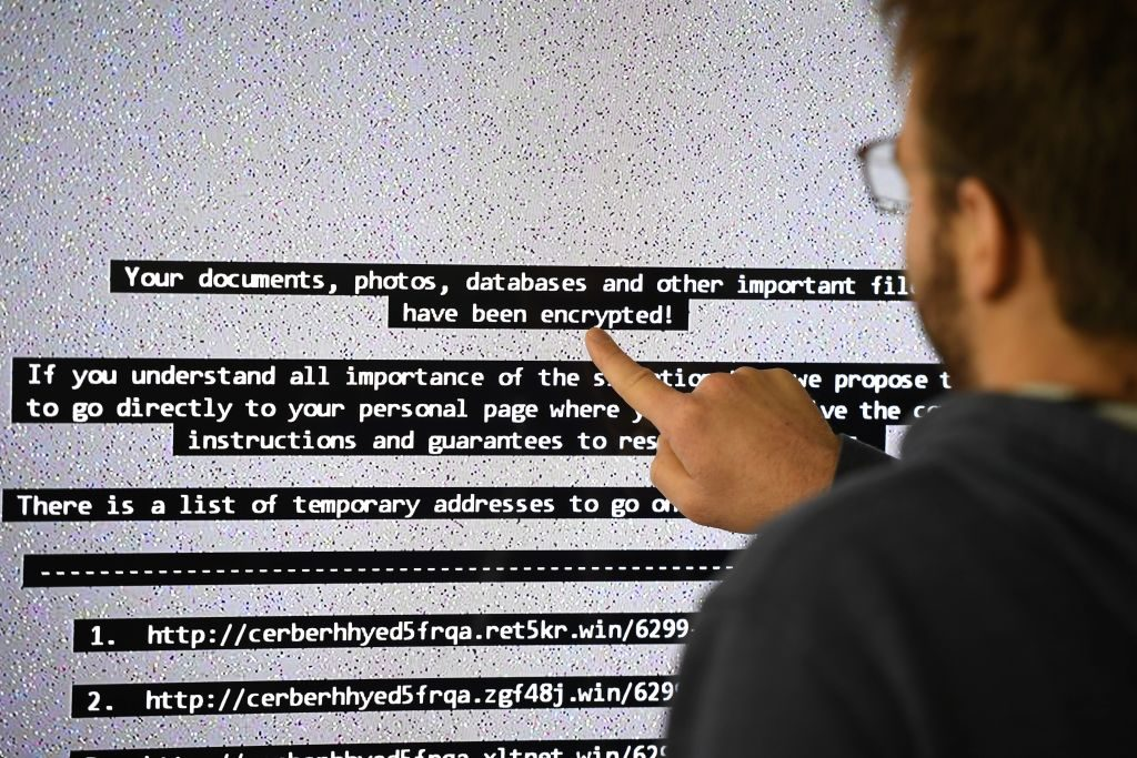 An IT researchers shows on a giant screen a computer infected by ransomware in 2016.