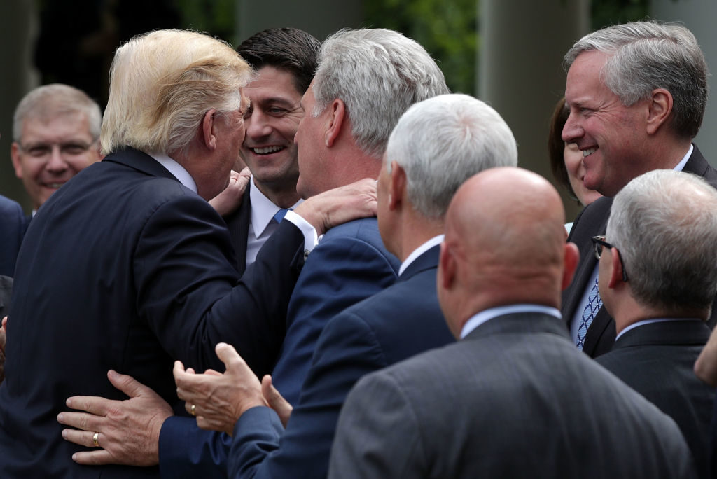 President Donald Trump shares a moment with Speaker of the House Paul Ryan (R-WI) at the White House May 4 after the House narrowly passes (217-213) the American Health Care Act to replace the Obama administration's Affordable Care Act.