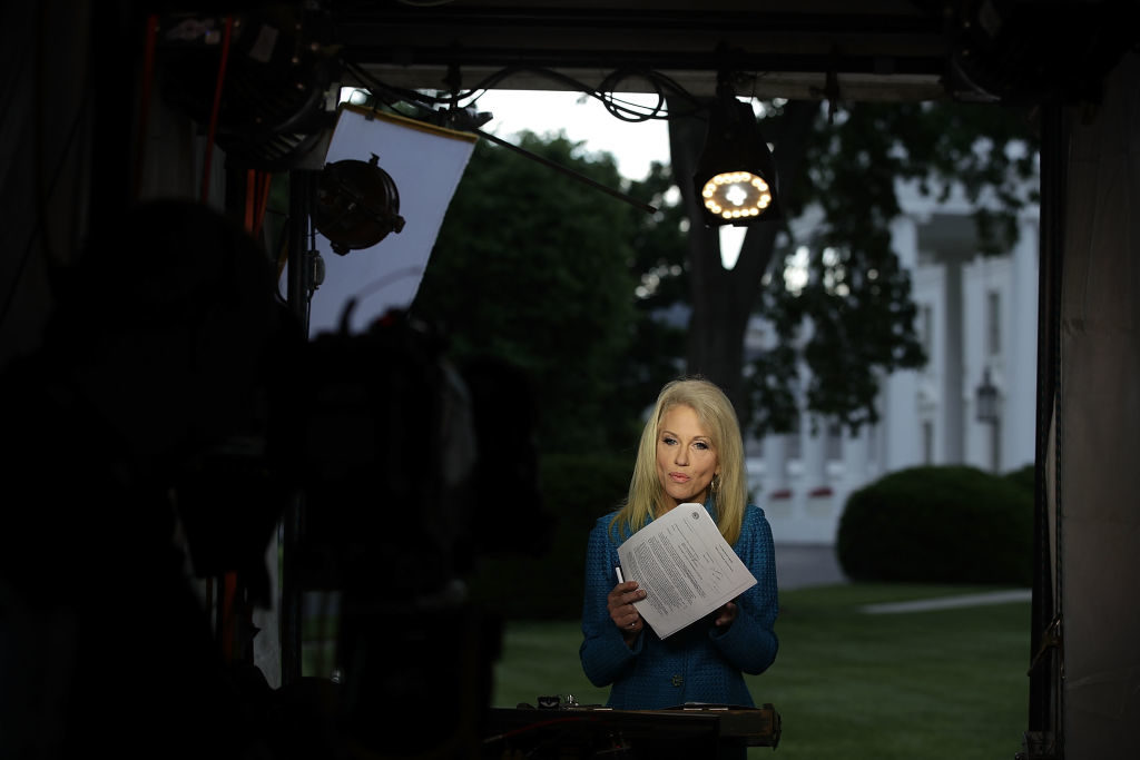 White House Counselor Kellyanne Conway holds up a copy of a memo from Deputy Attorney General Rod Rosenstein during an interview with CNN at the White House May 10, 2017. FBI Director James Comey was fired by President Donald Trump the day before.