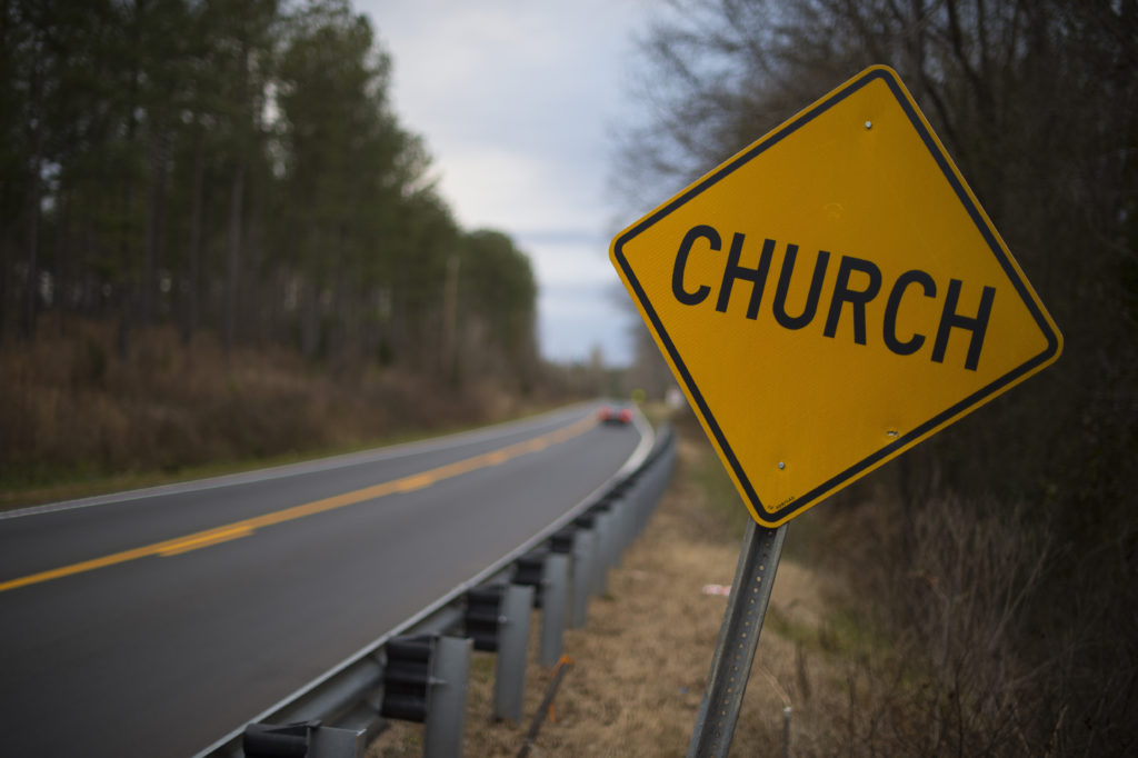 A sign warning to yield for a church is posted on a road near Anderson, South Carolina