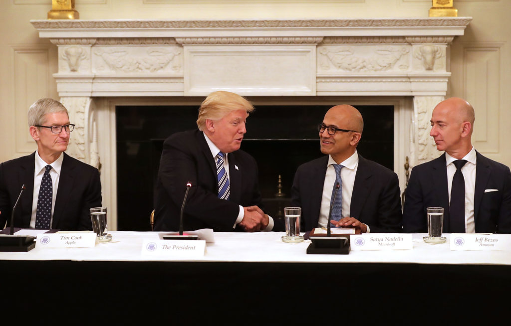 President Donald Trump welcomes members of his American Technology Council, including (L-R) Apple CEO Tim Cook, Microsoft CEO Satya Nadella and Amazon CEO Jeff Bezos in the State Dining Room of the White House June 19, 2017. Some critics say these big tech companies are getting too big and the government should break them up.