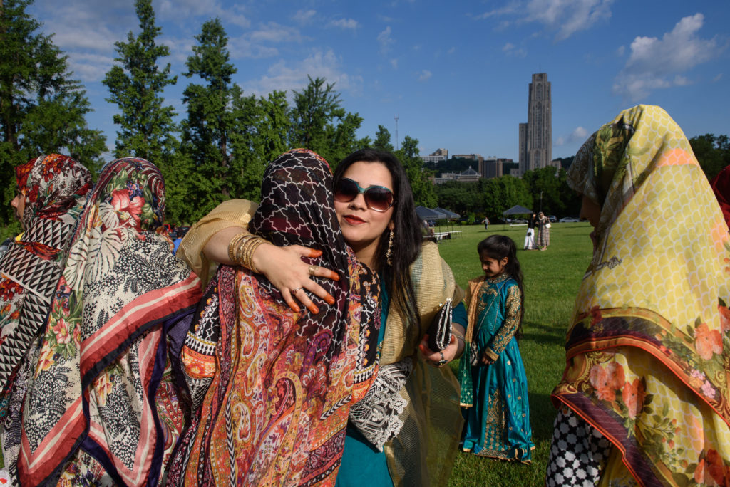 PITTSBURGH, PA - JUNE 25: Shahnila Rubab of South Fayette, Pennsylvania hugs friends as they gather with fellow Muslims to for Eid al-Fitr, a celebration marking the end of Ramadan, on June 25, 2017 in Pittsburgh, Pennsylvania. The celebration marks the ending of the fasting month of Ramadan and the beginning of Shawwal and six more days of fasting.. Becasue Eid al-Fitr starts when the new moon is spotted, it is celebrated on different days around the world.