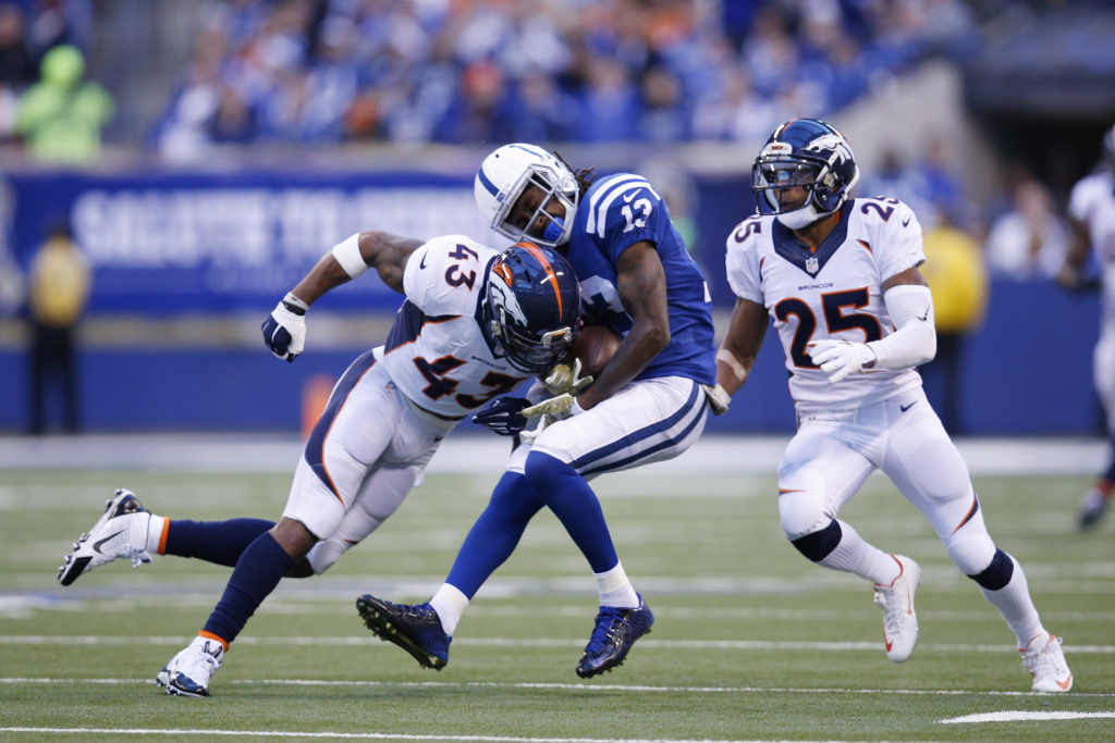 T.J. Ward #43  of the Denver Broncos tackles on T.Y Hilton #13 of the Indianapolis Colts in the first quarter of the game at Lucas Oil Stadium on November 8, 2015 in Indianapolis, Indiana.