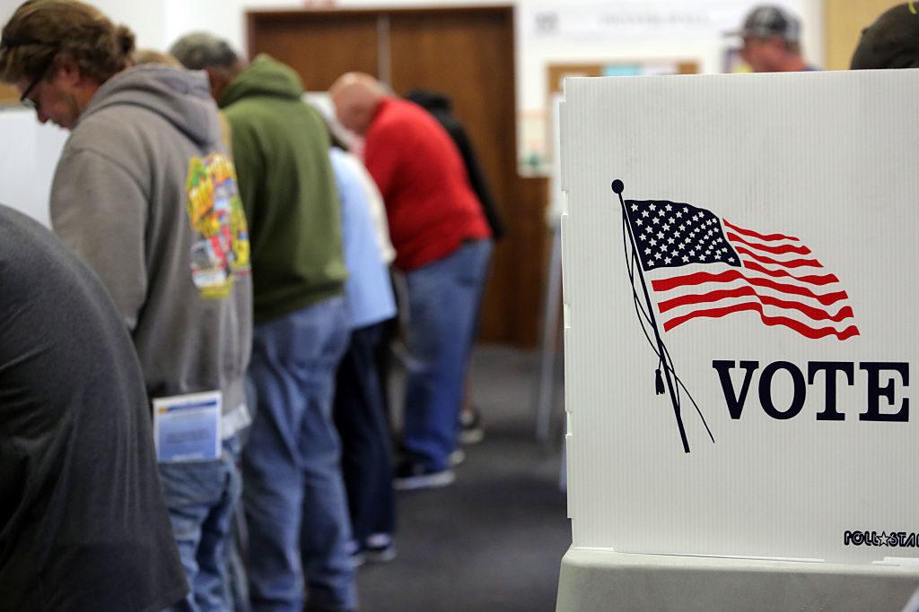 Voters cast ballots at a polling station at the Big Bear Lake Methodist Church in Big Bear, Calif., November 8, 2016.