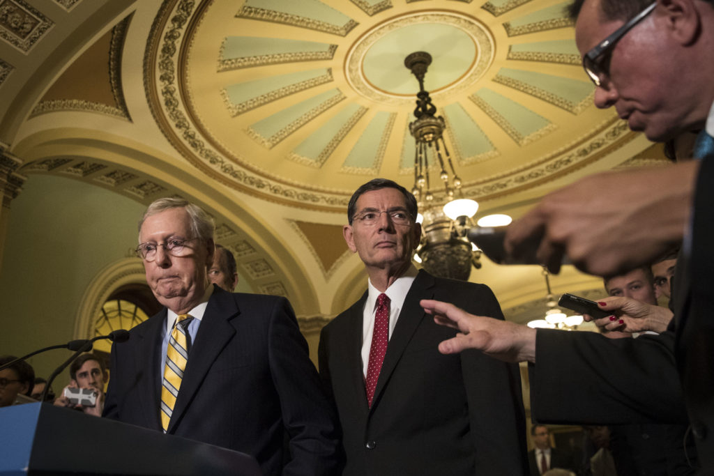 WASHINGTON, DC - JUNE 27: (L to R) Senate Majority Leader Mitch McConnell (R-KY) listens to a question as Sen. John Barrasso (R-WY) looks on during a press conference after a closed-door Senate GOP conference meeting on Capitol Hill, June 27, 2017 in Washington, DC.