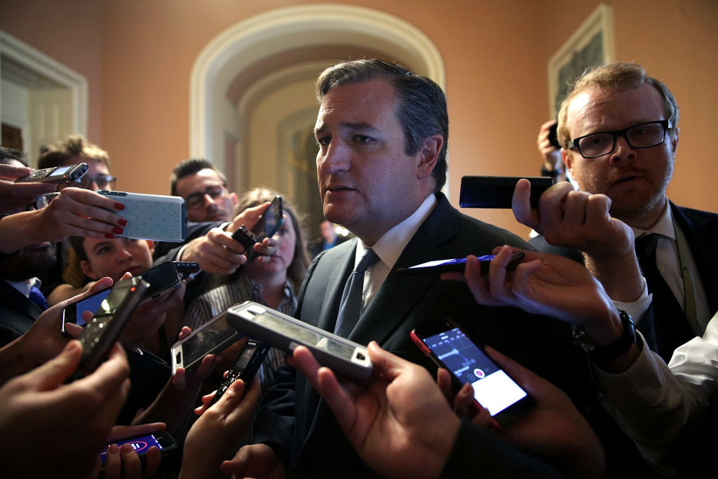 U.S. Sen. Ted Cruz, R-TX, is surrounded by members of the media after he viewed the details of a new health care bill.