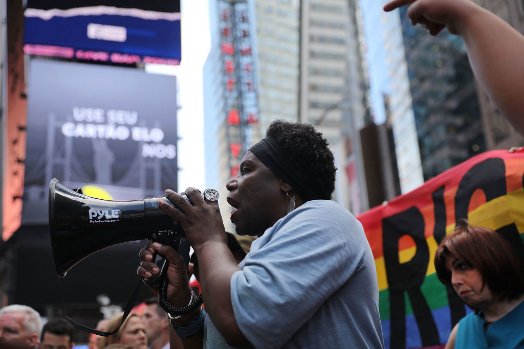 Transgender Army veteran Tanya Walker speaks to protesters in Times Square near a military recruitment center as they show their anger at President Donald Trump's tweet that he would ban transgender individuals from serving in the military.