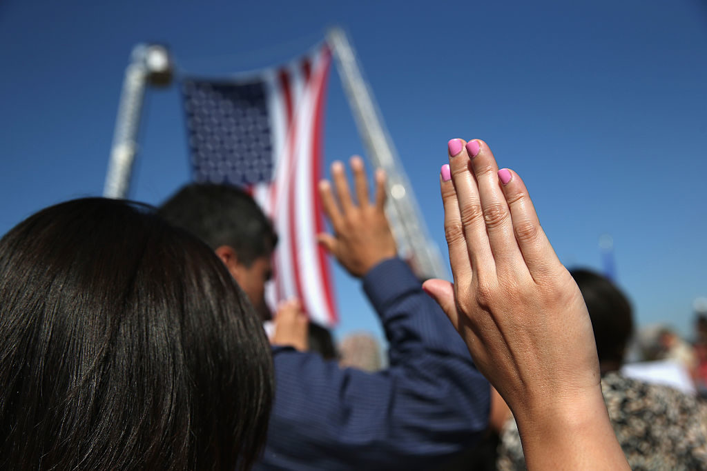 One hundred immigrants become American citizens during a naturalization ceremony at Liberty State Park in 2015.