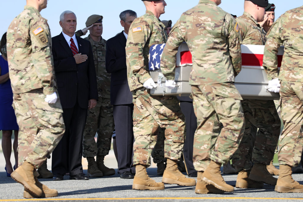 U.S. Vice President Mike Pence stands with his hand over his heart as U.S. Army soldiers carry the flag-draped transfer case containing the remains of U.S. Army Ranger Sgt. Joshua P. Rodgers during a dignified transfer at Dover Air Force Base on April 28, 2017 in Dover, Delaware. Sgt. Rogers, of Bloomington, Illinois, and Sgt. Cameron H. Thomas, of Kettering, Ohio, were U.S. Army soldiers killed while conducting a joint U.S.-Afghan raid in Nangarhar Province.