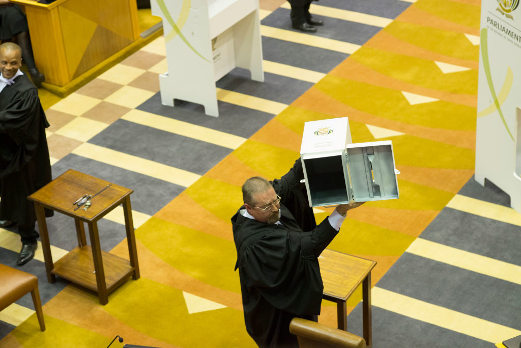 "A voting booth is brought into the South African parliament to allow Members of Parliament to vote for or against the motion of no-confidence against President Jacob Zuma. The opposition derided Zuma as a ""broken and corrupt"" leader Tuesday."