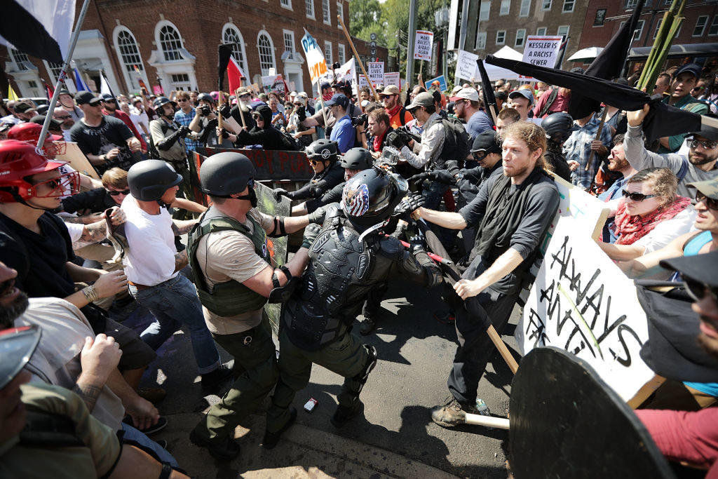 "White nationalists, neo-Nazis and members of the ""alt-right"" clash with counter-protesters as they enter Emancipation Park during the ""Unite the Right"" rally in Charlottesville, Virginia. After clashes with anti-fascist protesters and police the rally was declared an unlawful gathering and people were forced out of Emancipation Park, where a statue of Confederate General Robert E. Lee is slated to be removed."