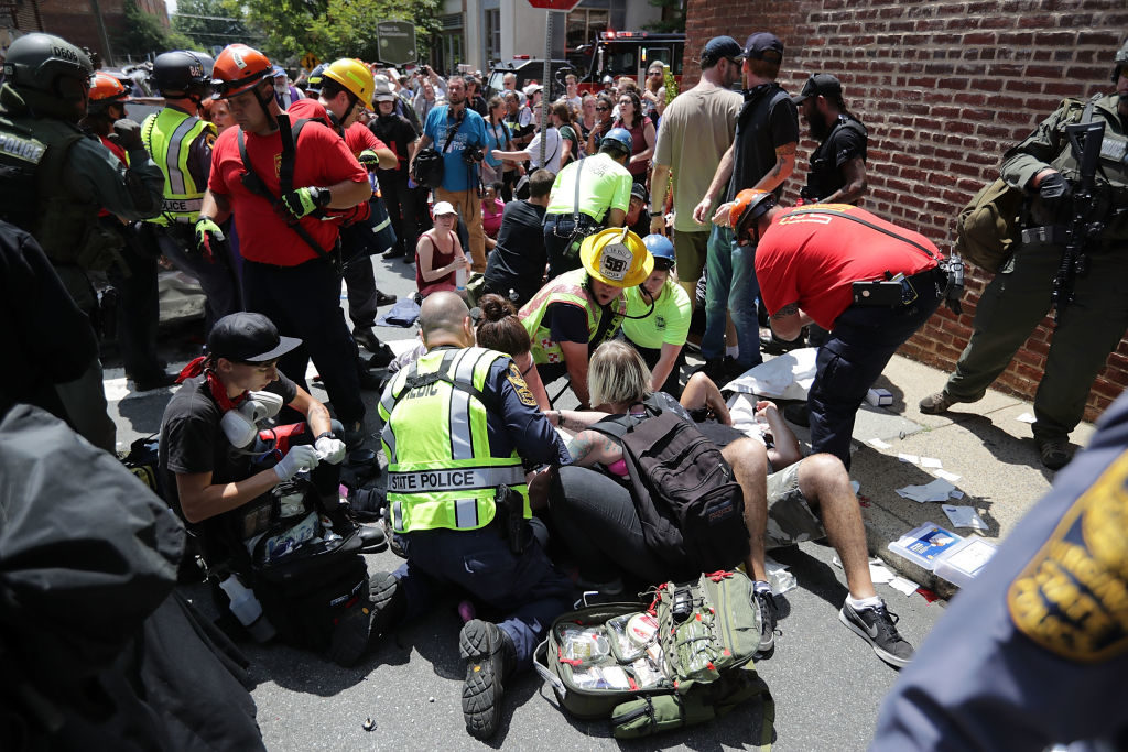 "Rescue workers and medics tend to people who were injured when a car plowed through a crowd of anti-facist counter-demonstrators marching through the downtown shopping district in Charlottesville, Virginia. The car plowed through the crowed following the shutdown of the ""Unite the Right"" rally by police after white nationalists, neo-Nazis and members of the ""alt-right"" and counter-protesters clashed near Lee Park, where a statue of Confederate General Robert E. Lee is slated to be removed."