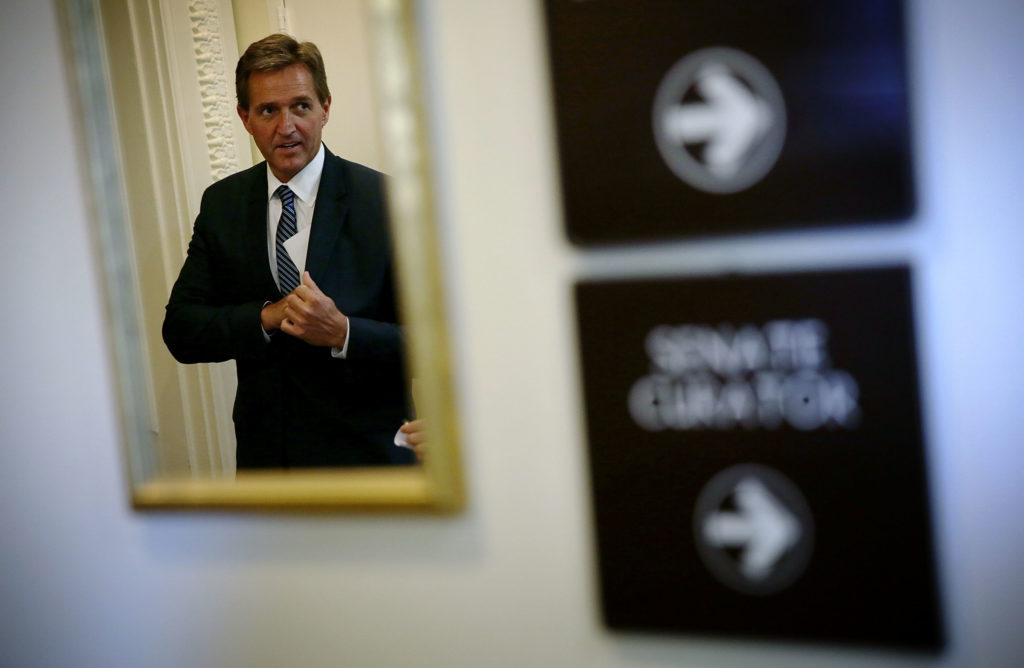 "U.S. Sen. Jeff Flake (R-AZ) arrives at a news conference November 4, 2015 on Capitol Hill in Washington, DC.   His book, ""Conscience of a Conservative,"" asks fellow Republicans to reflect on the future of the party."