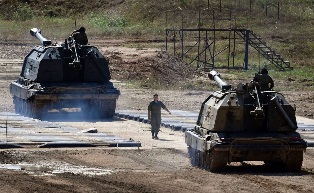 A Russian serviceman guides a 152-mm self propelled artillery unit 'Msta-S' in Kubinka Patriot Park outside Moscow on August 15, 2017.