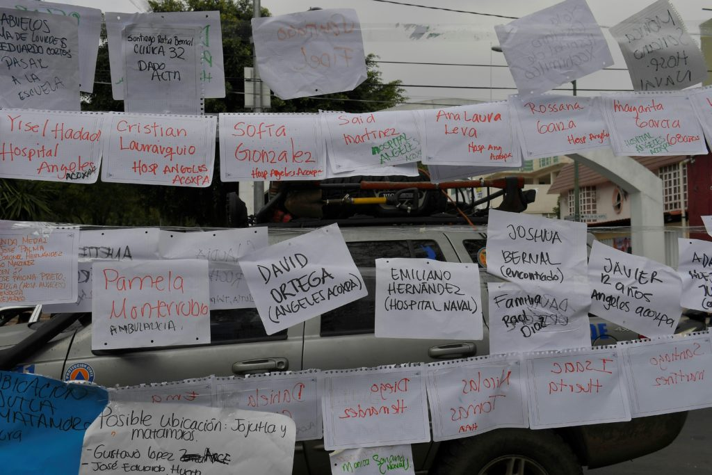 Sheets of paper display names and lists of people and the hospitals they are in near a school where at least 21 children died and more are missing in Mexico City on September 20, 2017 as the search for survivors continue after a strong 7.1 quake hit central Mexico on the 32nd anniversary of a devastating 1985 quake.