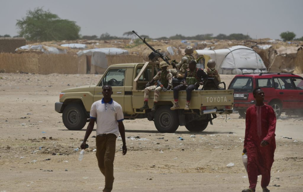 Niger's soldiers patrol near Bosso on June 17, 2016 following attacks by Boko Haram fighters in the region.  U.S. soldiers are stationed across the continent of Africa to help countries fight terrorism before large numbers of American troops are needed, according to White House chief of staff Gen. John Kelly.