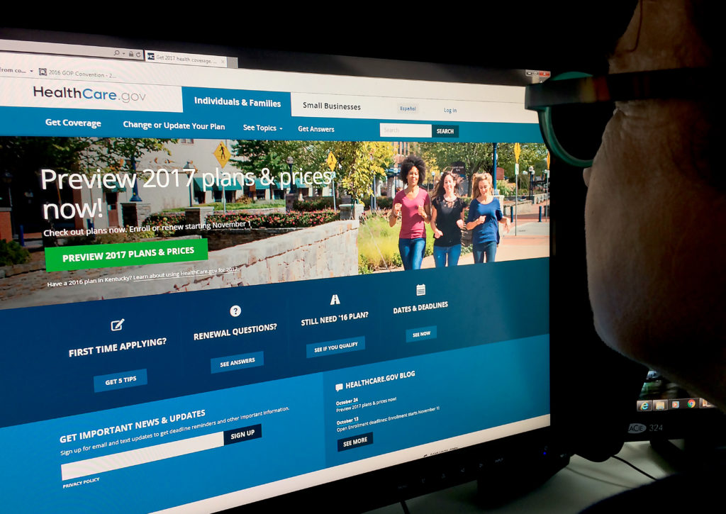 A woman looks at the Healthcare.gov internet site in Washington, DC.