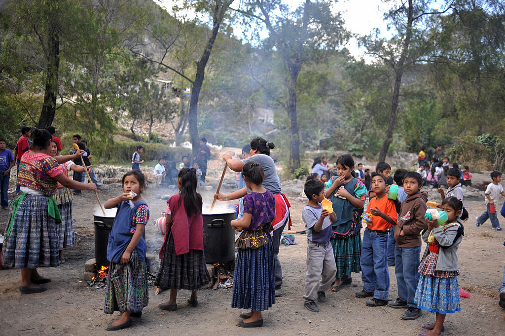 Children queue for a share of soup at a school in Chinautla, in the outskirts of Guatemala City on February 10, 2009.