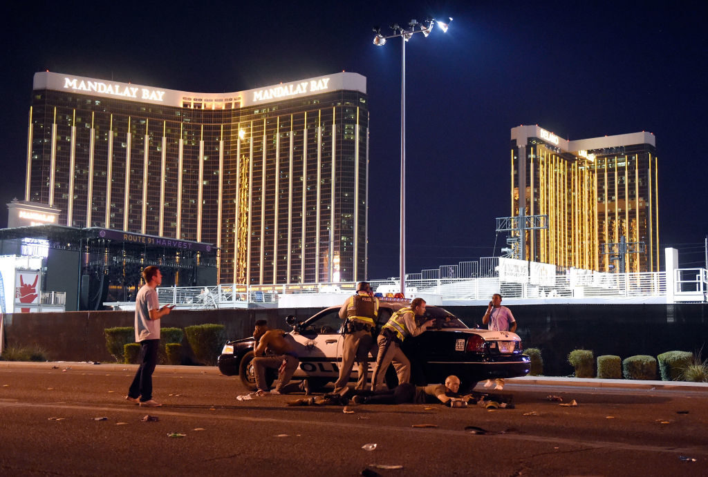 Las Vegas police stand guard after shots were fired at a music festival in the city.