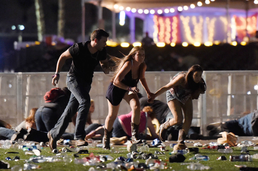 People run from the Route 91 Harvest country music festival in Las Vegas, Nevada.