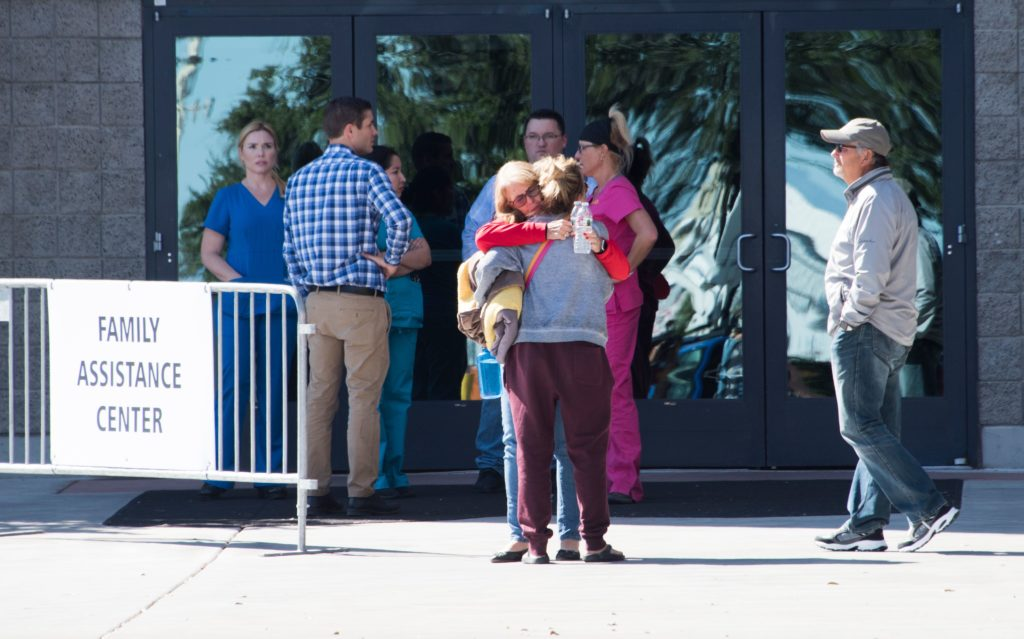 People react as they leave the family assistance center where family members were advised to go October 2, 2017 for more information about their loved one after a gunman killed 59 people and wounded more than 500 others when he opened fire on a country music concert in Las Vegas, Nevada late October 1, 2017.