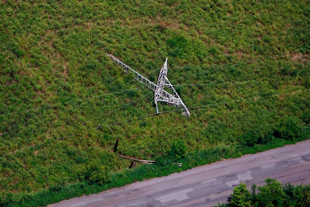 A power line tower lies fallen after the passing of Hurricane Maria in Naguabo, Puerto Rico.