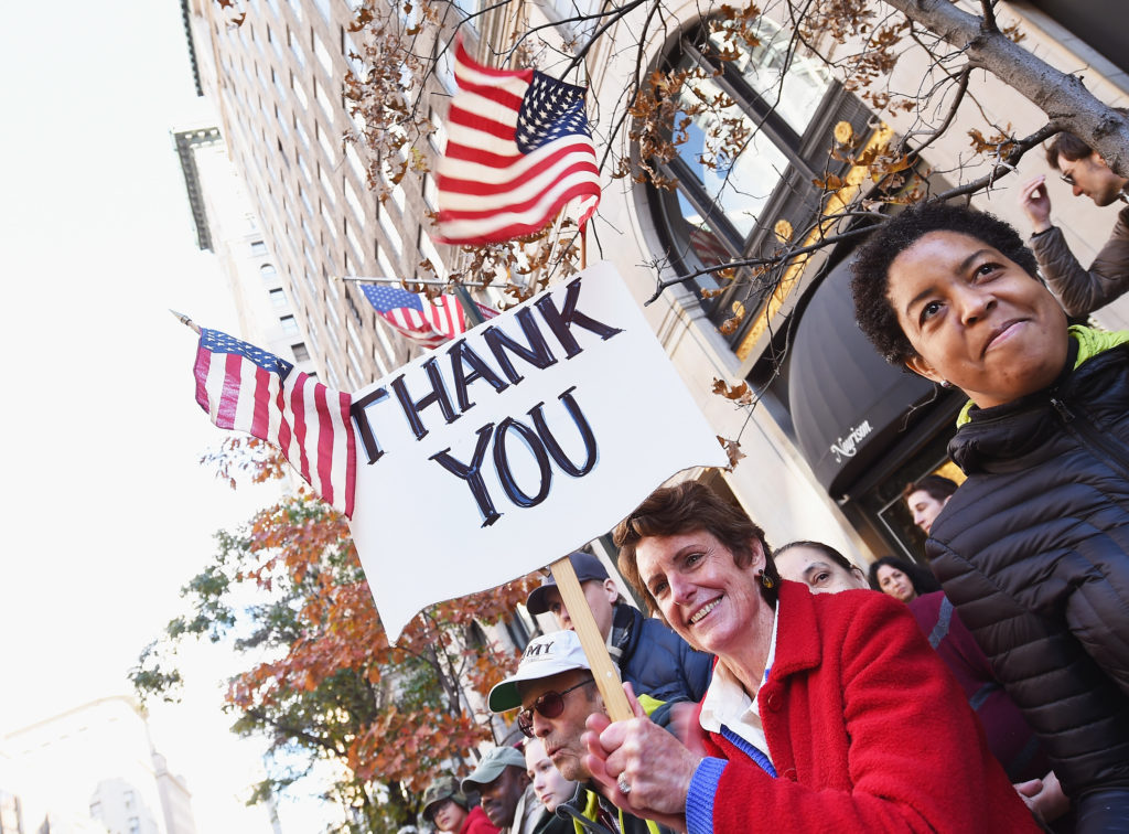Paradegoers attend the annual Veterans Day Parade on November 11, 2016 in New York City. Known as 'America's Parade' it features over 20,000 participants, including veterans of numerous eras, military units, businesses and high school bands and civic and youth groups.