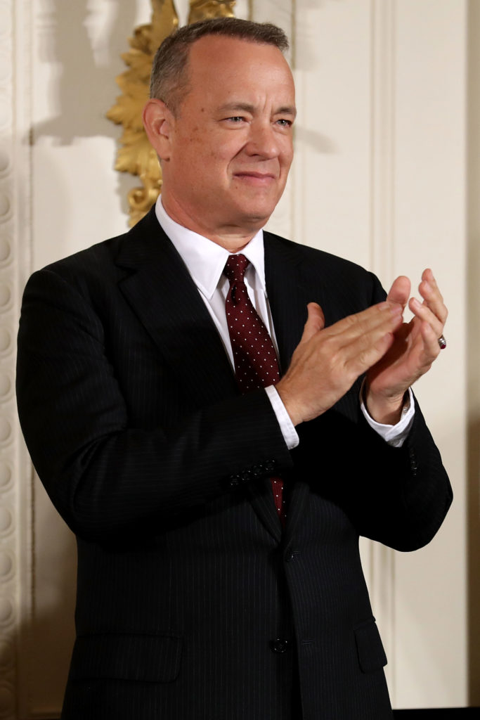 Actor, filmmaker and social justice advocate Tom Hanks applauds before being awarded the Presidential Medal of Freedom by U.S. President Barack Obama during a ceremony in the East Room of the White House November 22, 2016 in Washington, DC.