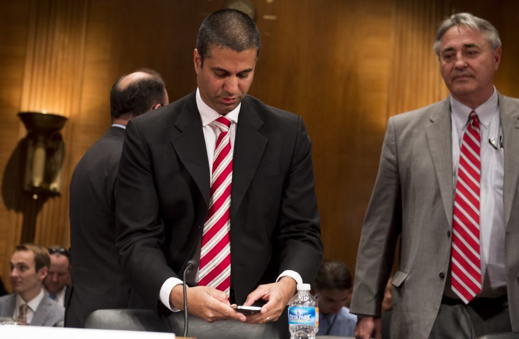 Chairman Ajit Pai of the Federal Communications Commission (FCC) uses his cellphone prior to testifying about the fiscal year 2018 budget request during an Appropriations Subcommittee on Financial Services and General Government hearing.