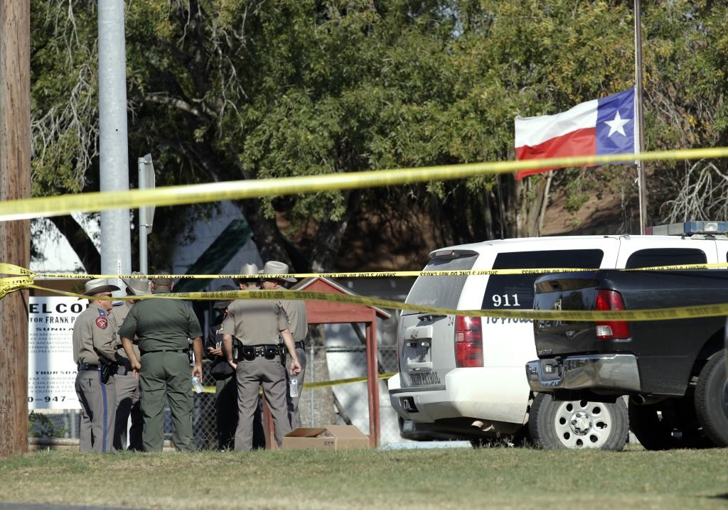 Law enforcement officials gather near the First Baptist Church following a shooting on November 5 in Sutherland Springs, Texas.