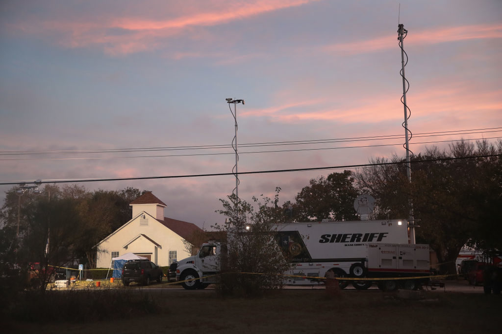 Law enforcement officials continue their investigation at Sutherland Springs Baptist Church as the sun begins to rise on November 6.