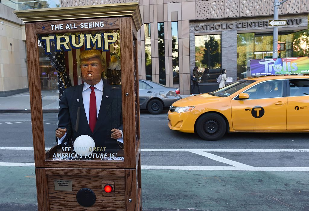A fortune-telling fairground attraction bearing the likeness of President Donald Trump stands at Washington Square Park in New York in fall 2016.