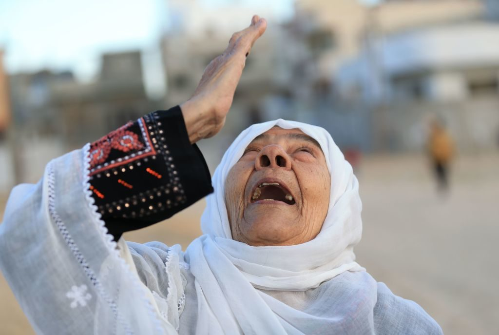 A series of clashes and protests erupted in the West Bank, Gaza Strip and east Jerusalem in the wake of President Donald Trump's recognition of Jerusalem as the capital of Israel, and Hamas called for a new intifada, or uprising. Here, a Palestinian woman reacts on a street in Beit Hanun in the northern Gaza Strip.