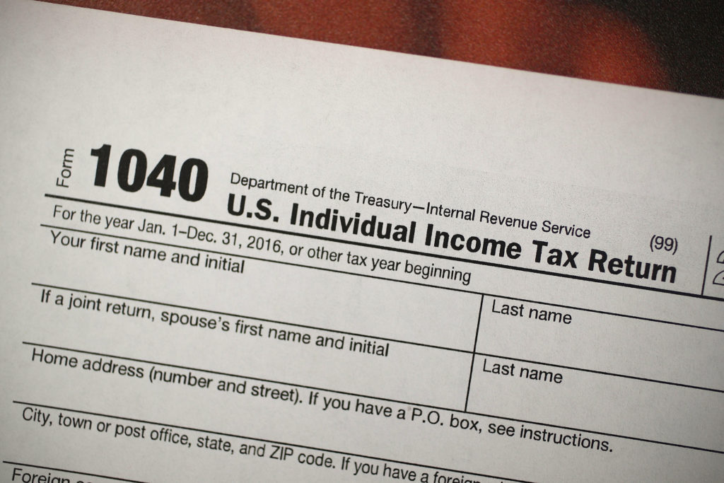 A copy of an IRS 1040 tax form at an H&R Block office on Dec. 22, 2017, the day President Trump signed the Republican tax bill.