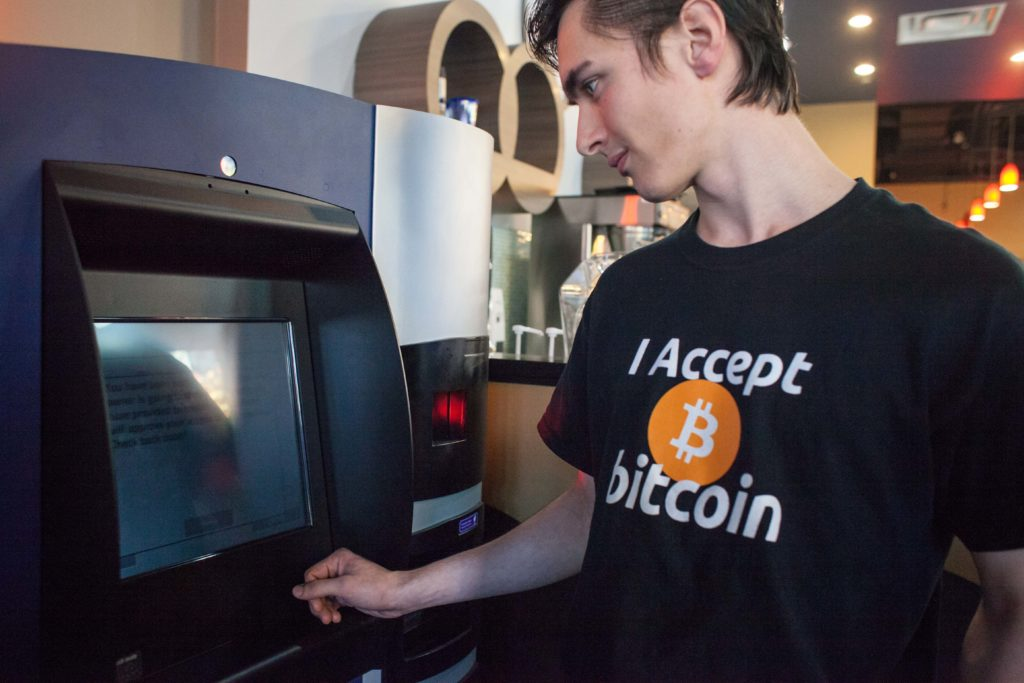 Gabriel Scheare uses a Bitcoin ATM in 2013. After years in relative obscurity, Bitcoin and other cryptocurrencies are now attracting major investments.