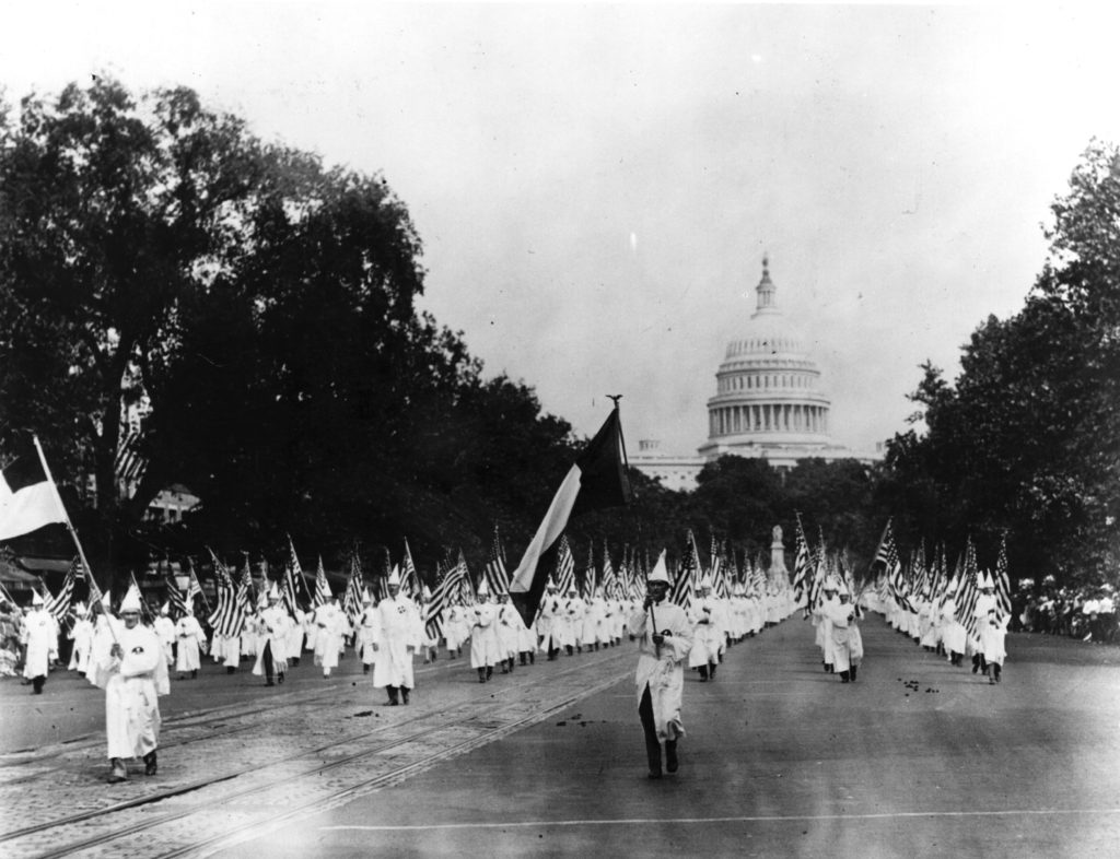 Members of the American white supremacist movement, the Ku Klux Klan, marching down Pennsylvania Avenue in Washington DC in 1925.